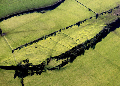 Plas Gwyn prehistoric settlement and field system, on a hill to the south of Benllech, was originally discovered during Royal Commission aerial survey in 1999. The group of roundhouse footings can be seen enclosed within a polygonal boundary.