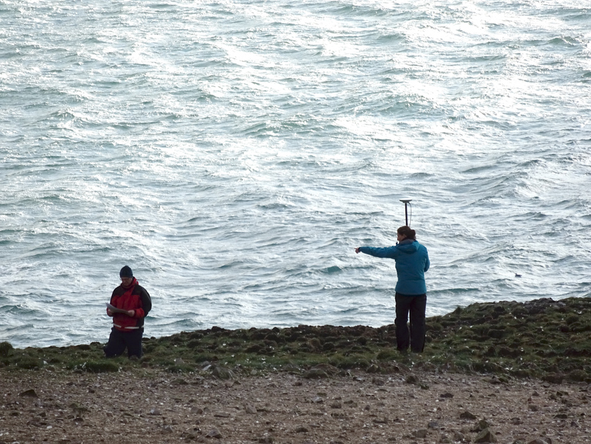 Louise and Toby surveying on Grassholm, seen against a wild sea. Photo courtesy of Greg Morgan, RSPB Ramsey Island.