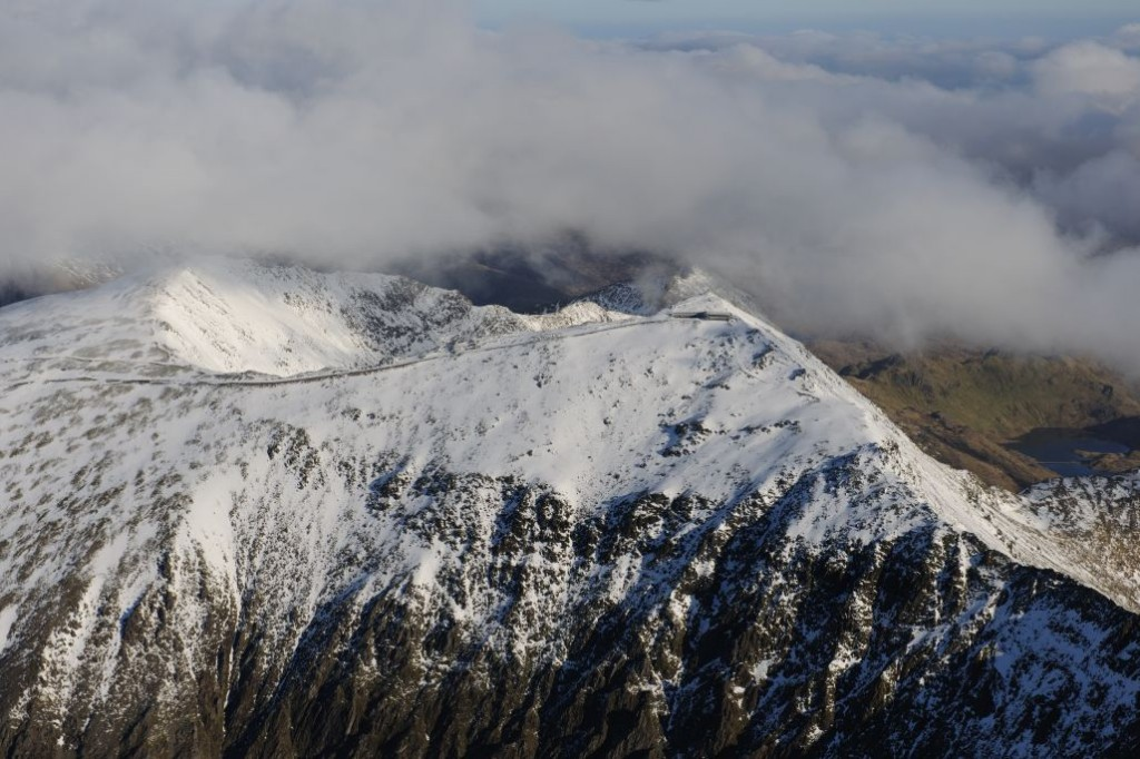 Royal Commission aerial photograph of Snowdon's snow-capped summit under snow, view from the west in 2012. NPRN: 32619