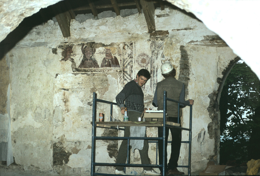 Conservationists at work on the wall paintings at St Teilo's Church, Llandeilo Talybont.