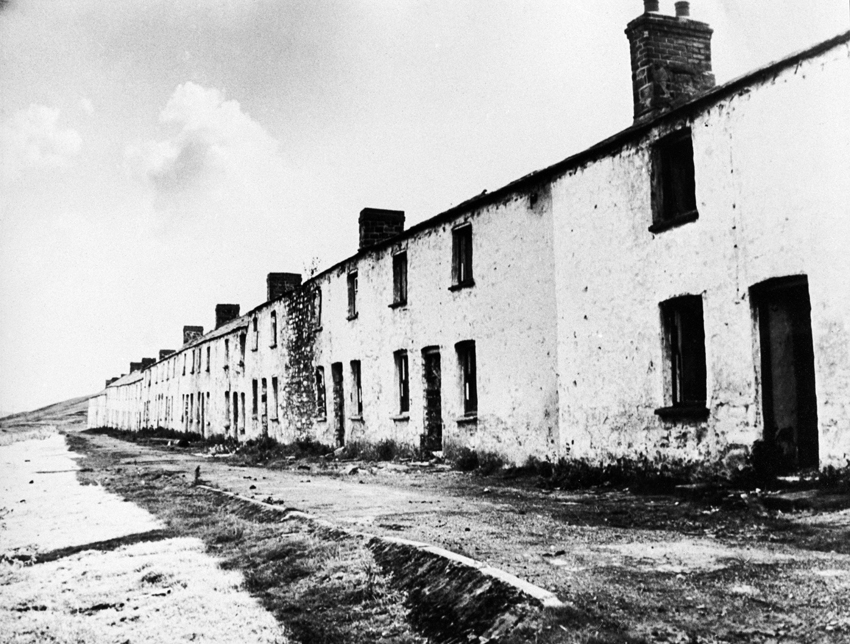 One of two rows of two-storey workers cottages in Onllwyn, now demolished (NPRN 407800).