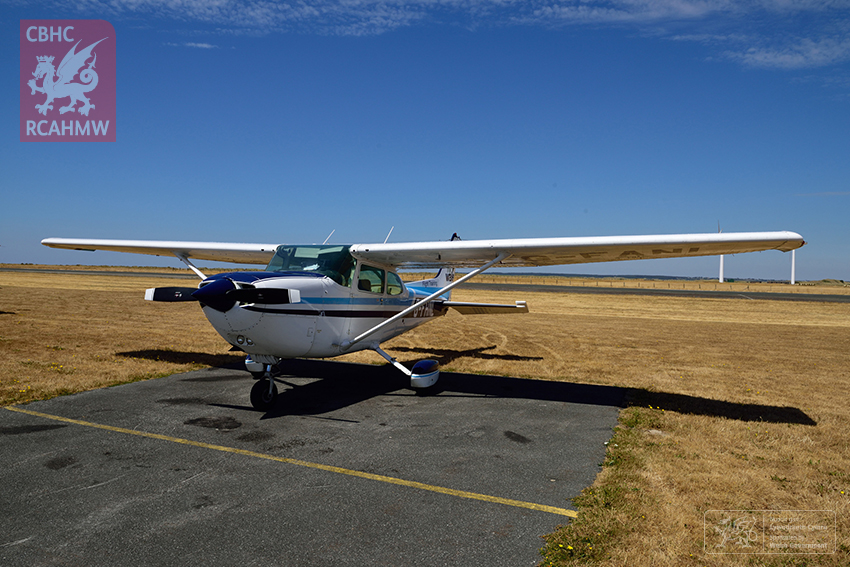 10 – Stopping for fuel and lunch at Caernarfon Airport in the FlyWales 4-seater Cessna aircraft (Crown Copyright RCAHMW)
