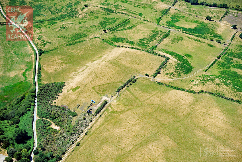 4 – Extensive cropmarks of prehistoric enclosures in parched grassland on the Llyn Peninsula (Crown Copyright RCAHMW)