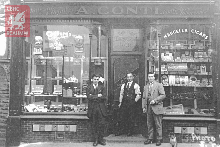 Attilio Conti and his brothers, Alf and Jack, outside the first Conti's cafe in Ystradgynlais. Ref. No. DI2008_0551 C.528019 NPRN: 407755