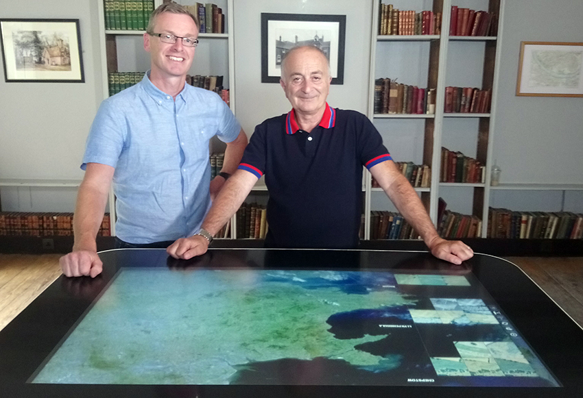 Dr Toby Driver discussing cropmark discoveries with Sir Tony Robinson