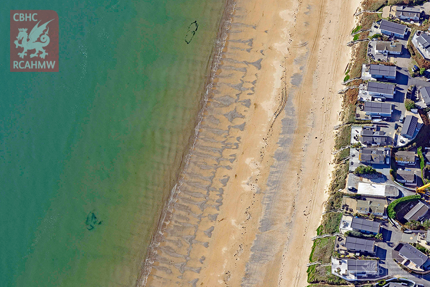 Abersoch. The outlines of two nineteenth-century wrecks are visible below the waterline at Abersoch, Gwynedd, both of which are under study for the CHERISH Project. The lower wreck was only recently revealed from the intertidal sand.