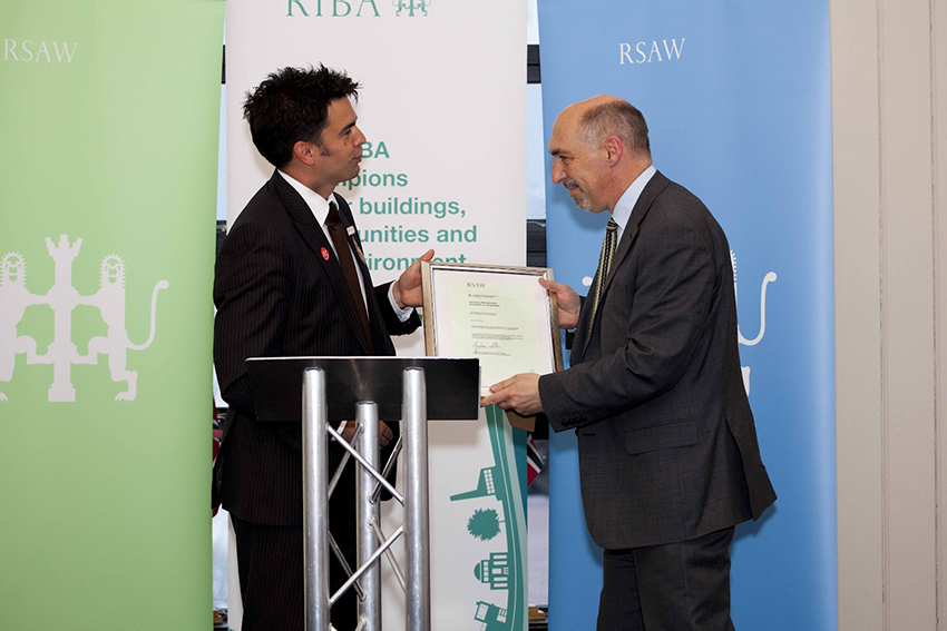 Dr Peter Wakelin, Secretary of the Royal Commission accepting his award at the RSAW ceremony held in Cardiff Bay.