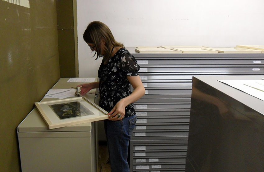 Rachael Barnwell, who has been working in partnership with colleagues at Ironbridge Gorge, measures up the exhibition frames.