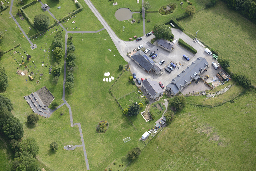 This 2015 aerial photograph of Pet Funeral Services Cemetery in Brynford, Holywell, clearly shows the distinctive paw-shaped lawn feature in the middle of the site.