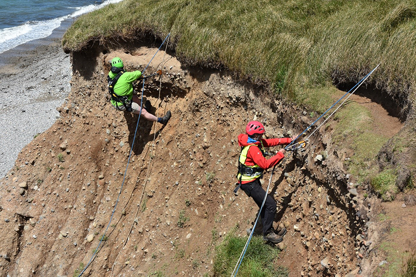 Don't look down! CHERISH team members Patrick and Louise battling with heights and ropes to record eroding features. (Crown Copyright: CHERISH)