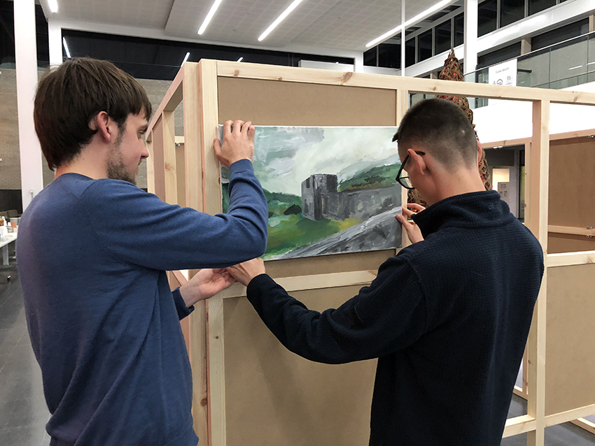 Youth panel members erecting the project group's exhibition at the Youth Voice Conference 2018 at St Fagans National Museum of History.