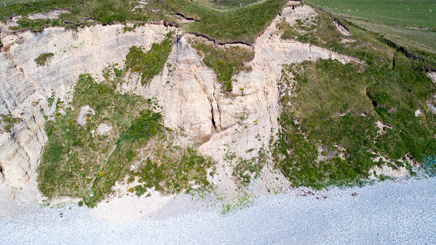 The southern hillfort ditch before and after fresh cliff collapse