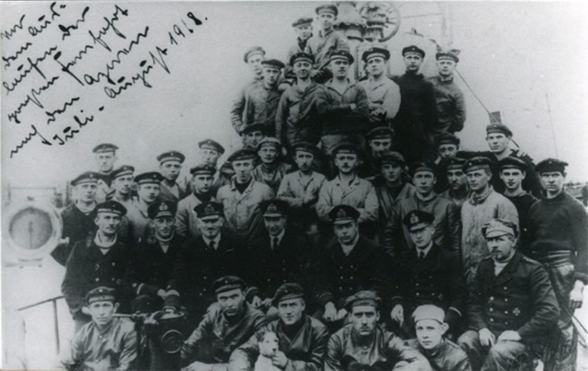 Lotte, centre front row, posing with the crew of U 91 before their departure on a patrol around the Azores in July and August 1918