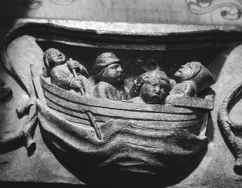 This medieval misericord from St David's Cathedral depicts the cramped and miserable conditions on board a medieval ship. ©Crown copyright: RCAHMW
