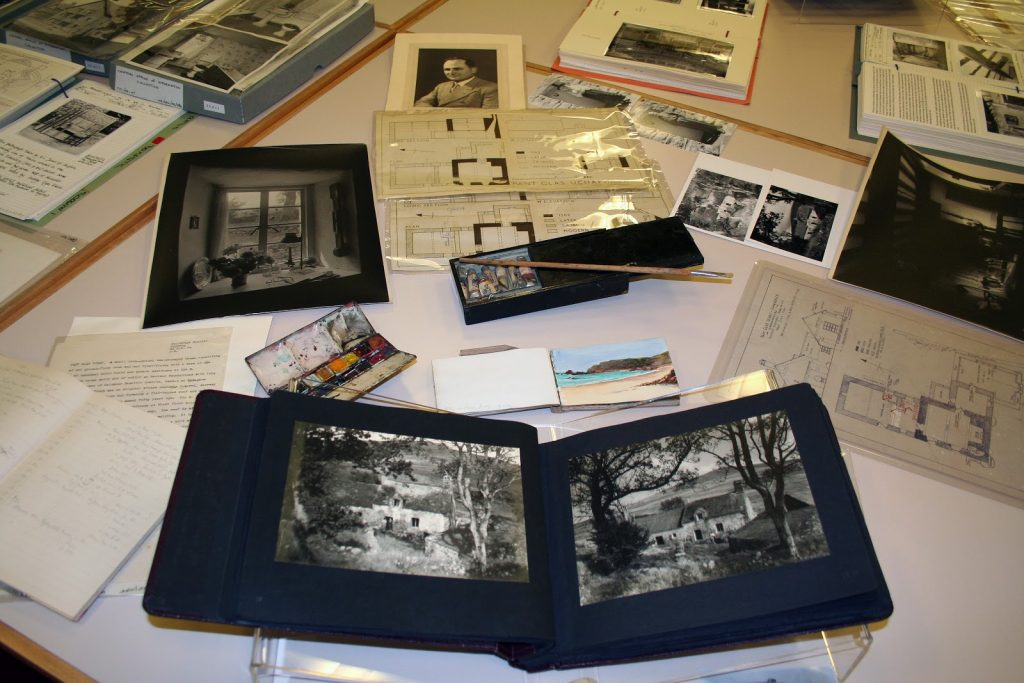 Original documents and photographs on display, held by the Royal Commission's archive the National Monuments Record of Wales.