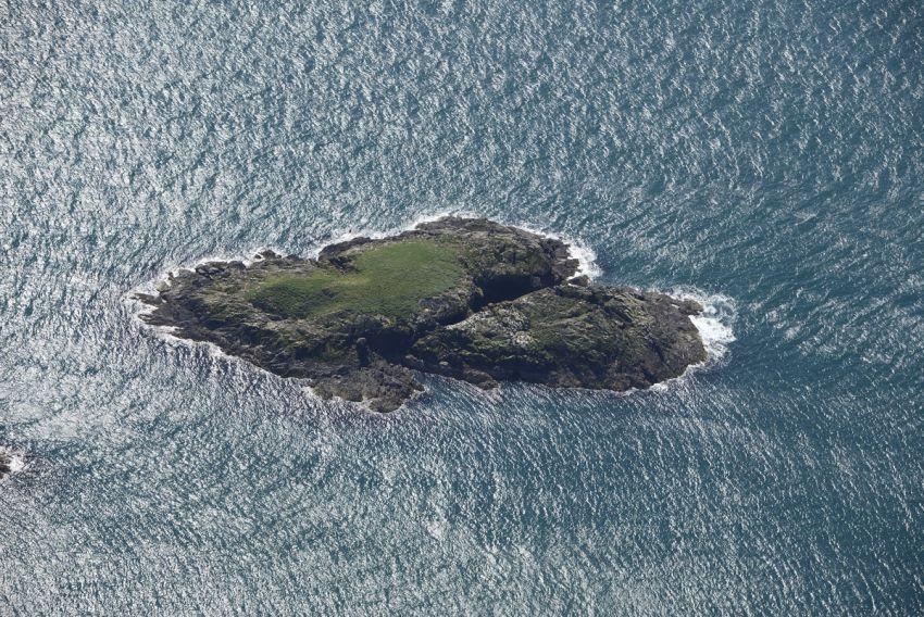 Colour oblique aerial photograph of Ynys Gwylan, 03-05-2017, Ref. CH2019_179_001 C.658899 NPRN 544002
