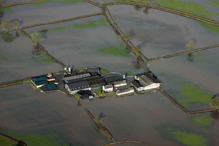 Glantowy Fawr farmhouse and farm on the floodplain of the River Tywi showing the effects of increased rainfall on historic assets
