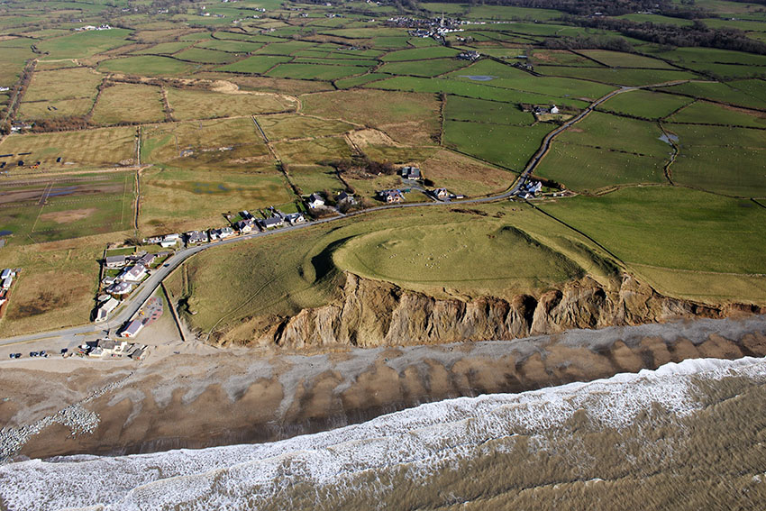 The eroding cliff face of Dinas Dinlle coastal hillfort, Gwynedd