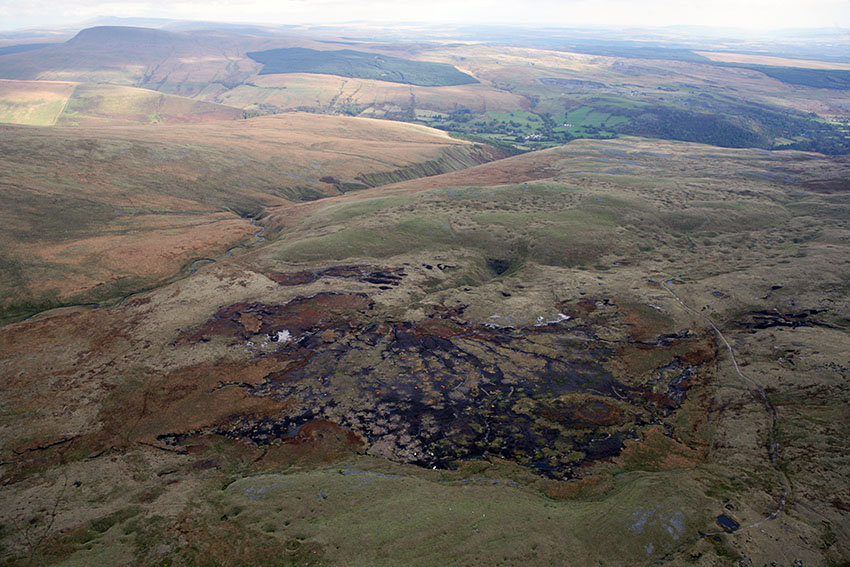 Waun Fignen Felin peat erosion channels contrasting with the ongoing conservation restoration work within the site