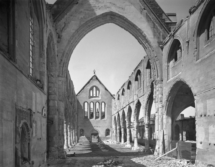 Photographed after the bombs fell: too late to record its original state but unquestionably a valuable record both of the structure and the damage sustained, St Mary's Church, Swansea. Interior view looking west showing damage to the church caused by enemy action taken in June 1941. C460853.