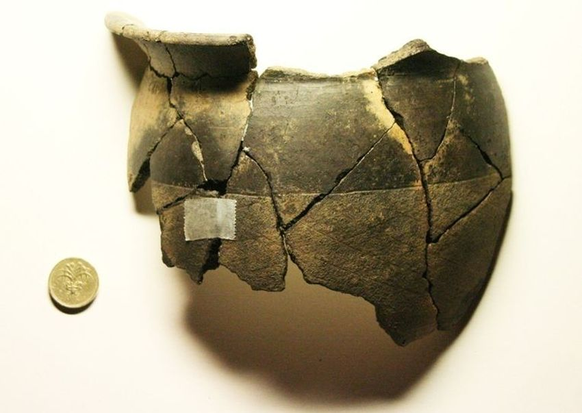 A Roman pot from Dorset, dropped into a fireplace and never collected, perhaps during the fire which consumed most of the villa?
