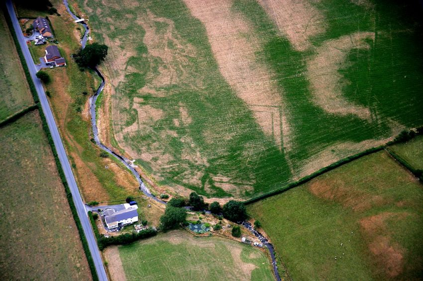 Cropmarks in the dry summer of 2006 revealed an unusual double-ditched enclosure with a stone building within. Something interesting had appeared, but what?