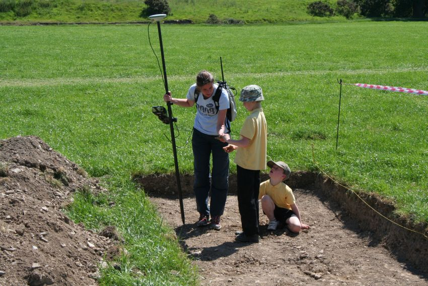 Teaching surveying to young archaeologists in the children's trench, 2011.