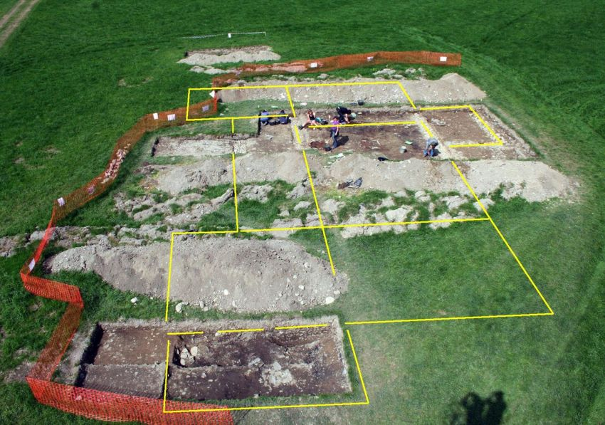 The buried extent of the villa marked with yellow lines, seen during the 2011 excavations.