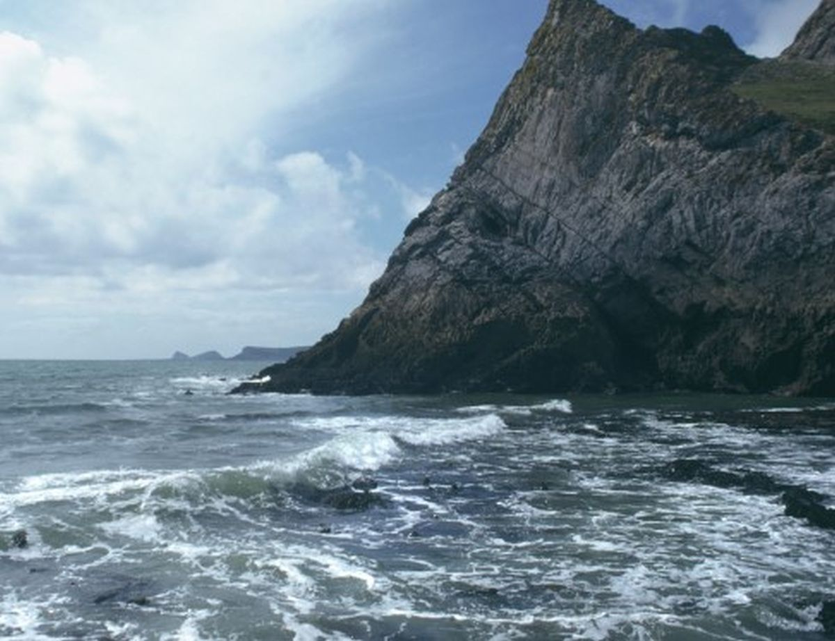 View of coastal landscape along cliff line towards Wormshead, 1997