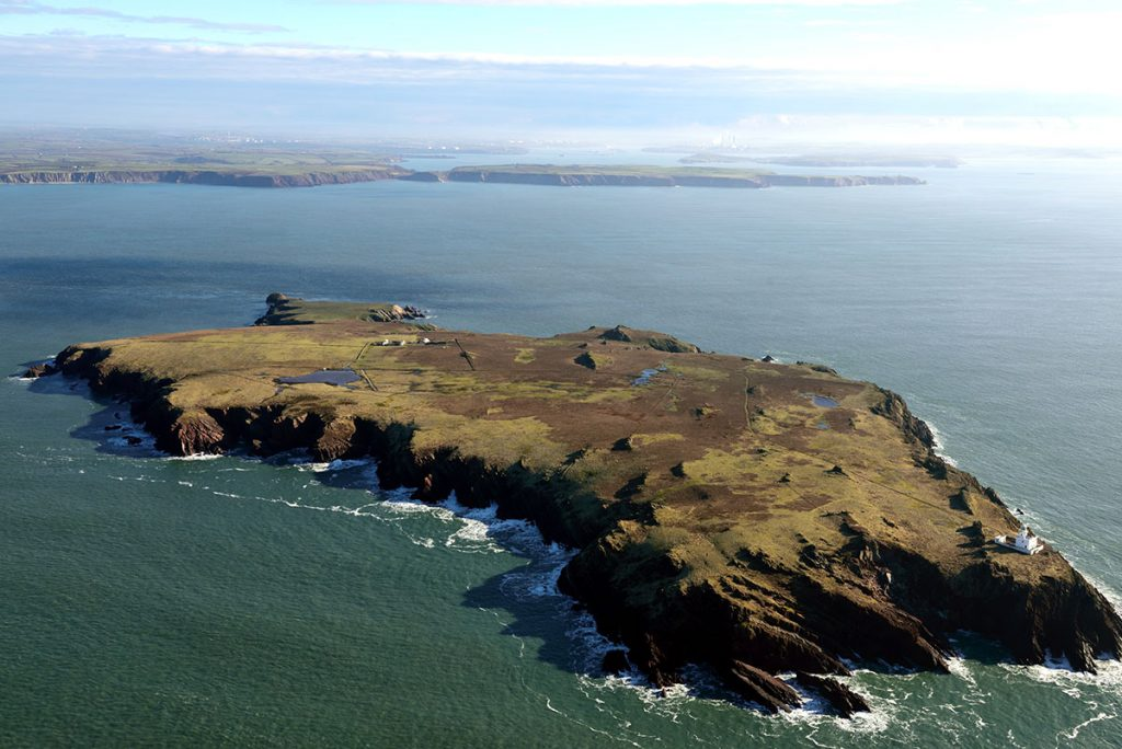 1.Skokholm Island from the air, on 5th February 2018. The new archaeological finds were discovered by the cottages on the far side of the island (© Crown: CHERISH PROJECT 2018. Produced with EU funds through the Ireland Wales Co-operation Programme 2014-2022).