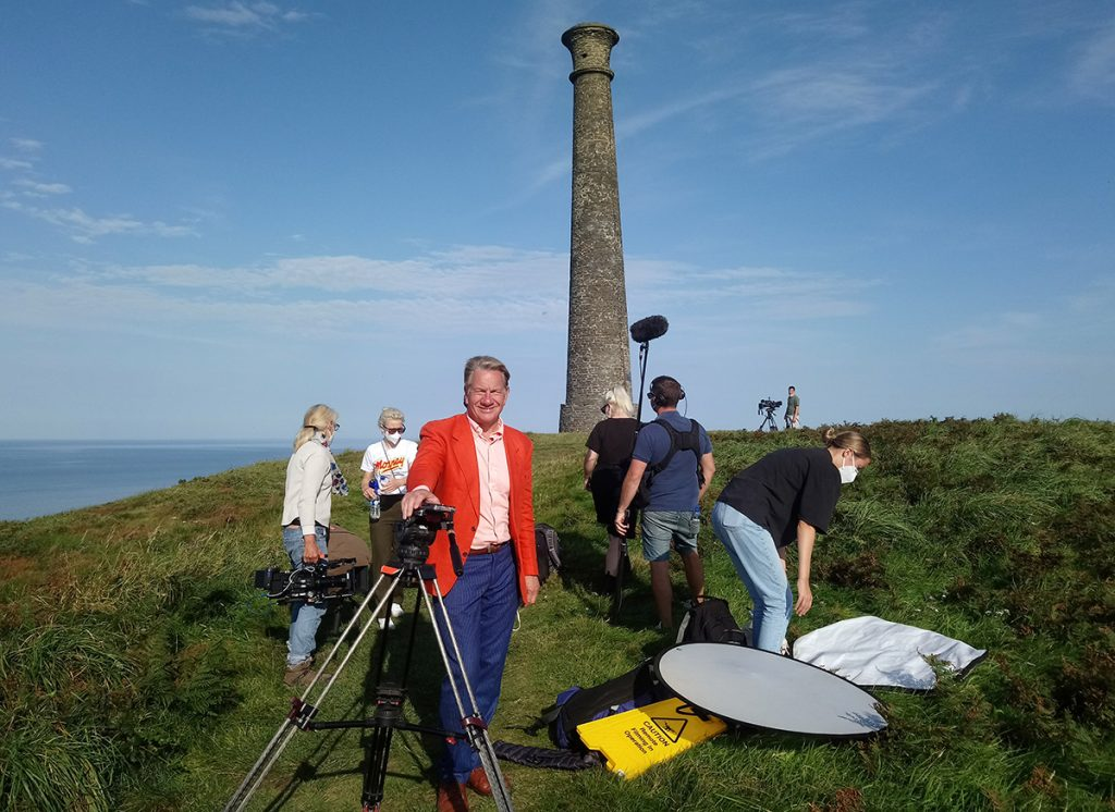 Michael Portillo and the production team filming on Pen Dinas with the Royal Commission, September 2020 (Crown Copyright RCAHMW).